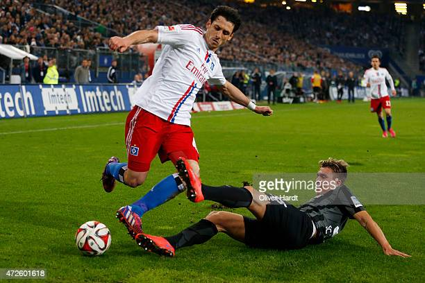 Gojko Kacar of Hamburg and Felix Klaus of Freiburg compete for the ball during the First Bundesliga match between Hamburger SV and SC Freiburg at...
