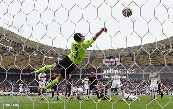 Gojko Kacar of Hamburg scores his team's first goal past goalkeeper Sven Ulreich of Stuttgart during the Bundesliga match between VfB Stuttgart and...