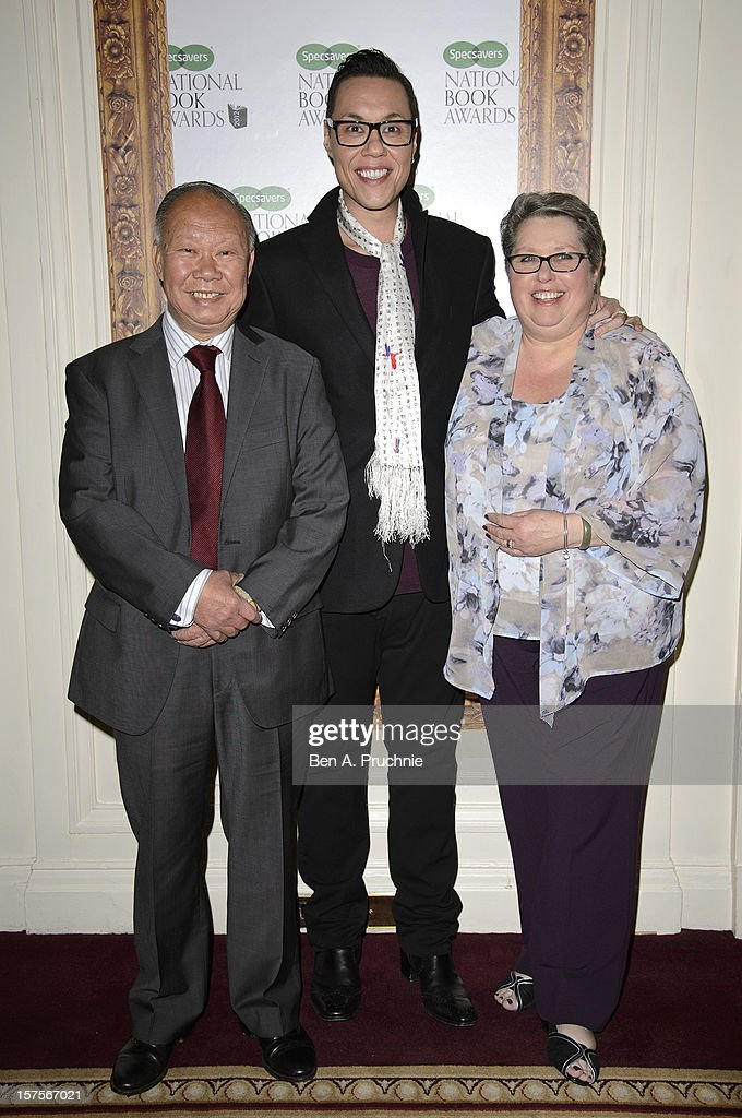 Gok Wan (C) and parents John and Myra attend the Specsavers National Book Awards at Mandarin Oriental Hyde Park on December 4, 2012 in London, England.