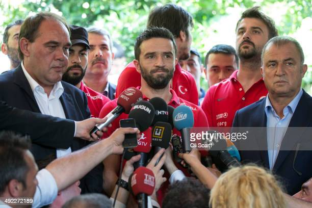 Gokhan Gonul a player in the Turkish national football team is joined by Fatih Terim the Manger of the Turkish national football team and Yildirim...