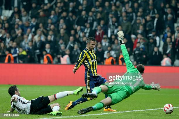 Gokhan Gonul and Fabricio Agosto Ramirez of Besiktas in action against Robin Van Persie of Fenerbahce during the Ziraat Turkish Cup soccer match...