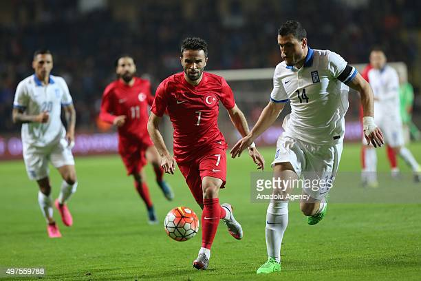 Gokhan Gonul of Turkey in action against Kyriakos Papadopoulos of Greece during an international friendly football match between Turkey and Greece at...