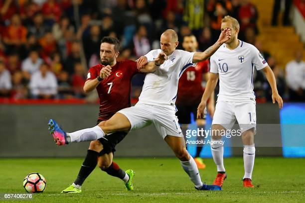 Gokhan Gonul of Turkey in action against Sakari Mattila of Finland during the 2018 FIFA World Cup Qualification match between Turkey and Finland at...