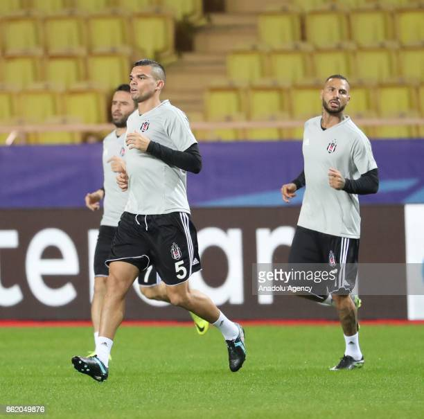 Gokhan Gonul Pepe and Quaresma of Besiktas attend a training session ahead of UEFA Champions League Group G match between Monaco and Besiktas at...