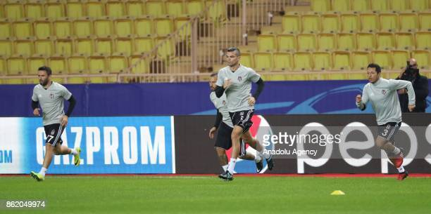 Gokhan Gonul Quaresma Pepe and Adriano of Besiktas attend a training session ahead of UEFA Champions League Group G match between Monaco and Besiktas...