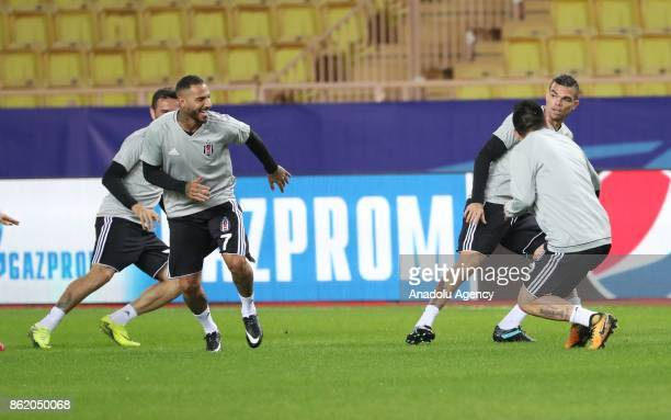 Gokhan Gonul Quaresma Pepe and Medel of Besiktas attend a training session ahead of UEFA Champions League Group G match between Monaco and Besiktas...