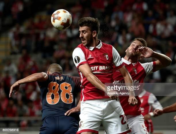 Gokhan Inler of Medipol Basaksehir in action against Paulinho of Sporting Braga during the UEFA Europa League Group C match between Sporting Braga...