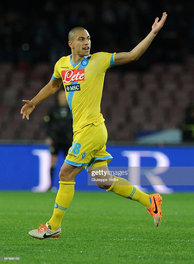 Gokhan Inler of Napoli celebrates after scoring the goal 1-1 during the Serie A match between SSC Napoli and AC Milan at Stadio San Paolo on February 8, 2014 in Naples, Italy.