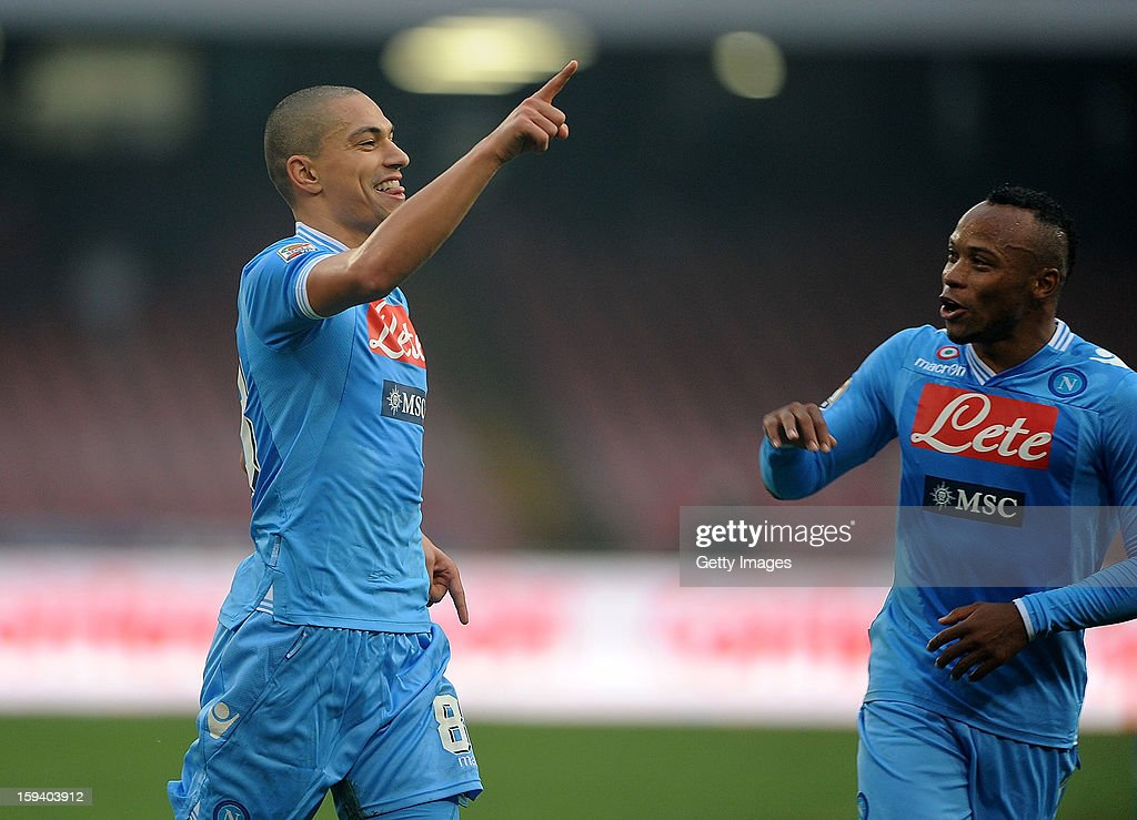 Gokhan Inler (L) of Napoli celebrates scoring the second goal with team mate Juan Camilo Zuniga during the Serie A match between SSC Napoli and US Citta di Palermo at Stadio San Paolo on January 13, 2013 in Naples, Italy.