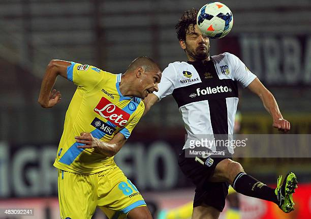 Gokhan Inler of SSC Napoli competes with Marco Parolo of Parma FC during the Serie A match between Parma FC and SSC Napoli at Stadio Ennio Tardini on...