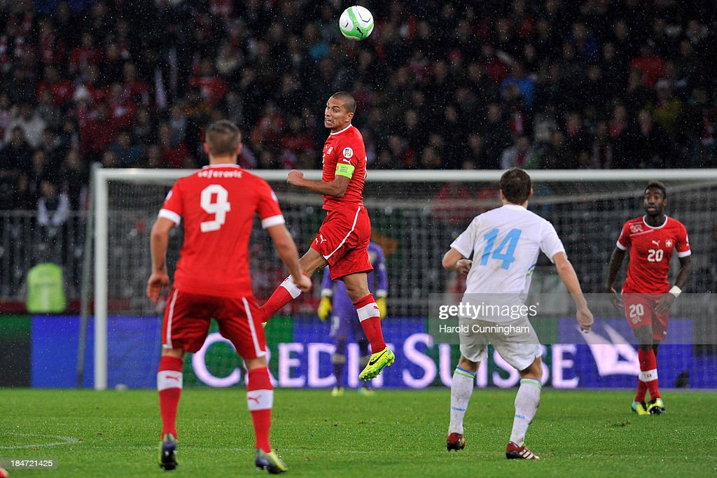 Gokhan Inler (C) of Switzerland in action during the FIFA 2014 World Cup Qualifier match between Switzerland and Slovenia match held at Stade de Suisse on October 15, 2013 in Bern, Switzerland.