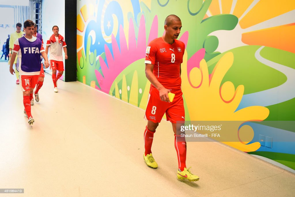 Gokhan Inler of Switzerland shows his dejection in the tunnel after the 0-1 defeat in the 2014 FIFA World Cup Brazil Round of 16 match between Argentina and Switzerland at Arena de Sao Paulo on July 1, 2014 in Sao Paulo, Brazil.