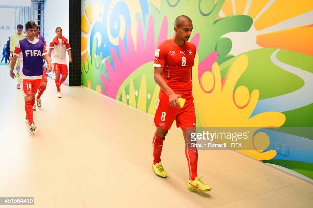 Gokhan Inler of Switzerland shows his dejection in the tunnel after the 01 defeat in the 2014 FIFA World Cup Brazil Round of 16 match between...