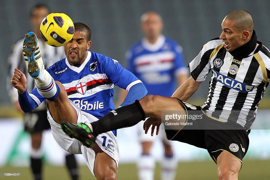 Gokhan Inler of Udinese Calcio fights for the ball with Fernando Damian Tisone of UC Sampdoria during the Serie A match between Udinese Calcio and UC Sampdoria at Stadio Friuli on February 5, 2011 in Udine, Italy.