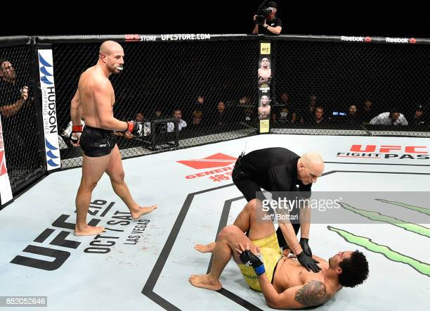 Gokhan Saki of Netherlands knocks out Henrique da Silva of Brazil in their light heavyweight bout during the UFC Fight Night event inside the Saitama...