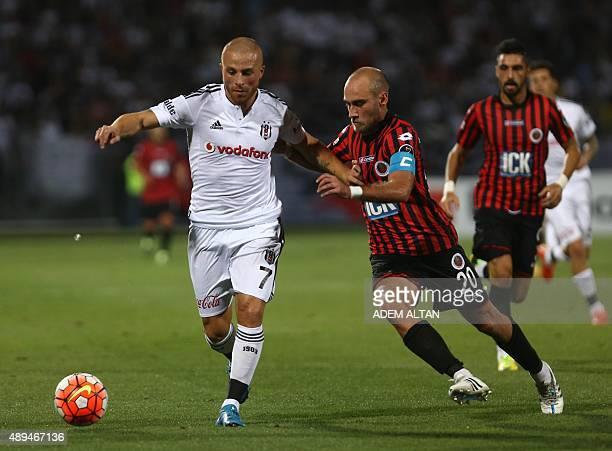 Gokhan Tore of Besiktas vies with Doga Kaya of Genclerbiriligi during Turkish Super League football match between Genclerbirligi and Besiktas in...