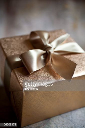 gold and elegant gift wrapping stock photo