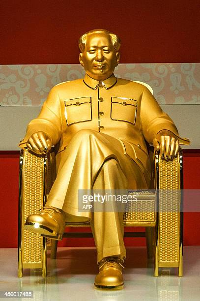 A gold and jade statue of Mao Zedong is displayed at an exhibition in Shenzhen south China's Guangdong province on December 13 2013 The statue worth...
