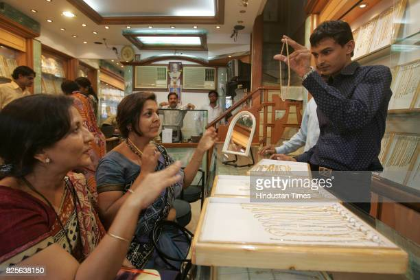 Gold and Jewellery Rekha Sanghvi and Santosh Jain at Umedmal Tilokchand Zaveri jewellery shop at Zaveri Bazaar Salesmen wait for the customers at...