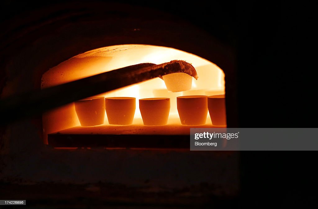 Gold and other metals are placed inside a furnace during the refinery process at Italpreziosi SpA factory in Arezzo, Italy, on Friday, July 19, 2013. Hedge funds raised bets on a gold rally before prices capped the biggest two-week gain in 20 months as Federal Reserve Chairman Ben S. Bernanke damped speculation that a cut in stimulus is imminent. Photographer: Alessia Pierdomenico/Bloomberg via Getty Images