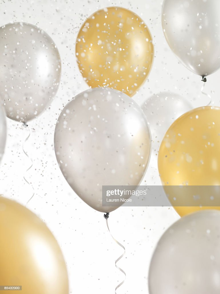 Gold and Silver Balloons with Confetti : Stock Photo