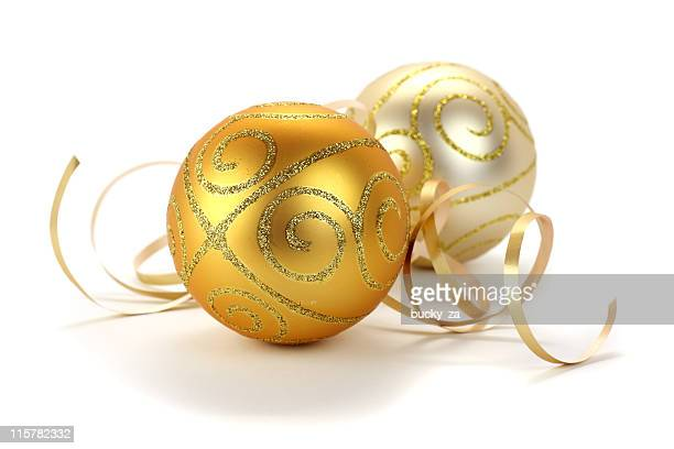 Gold and silver christmas decoration baubles on white background