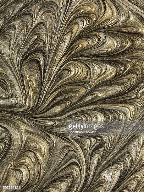 Gold and silver marbled paint pattern