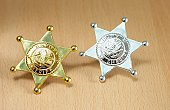 Gold and silver plastic Sheriff's badges.