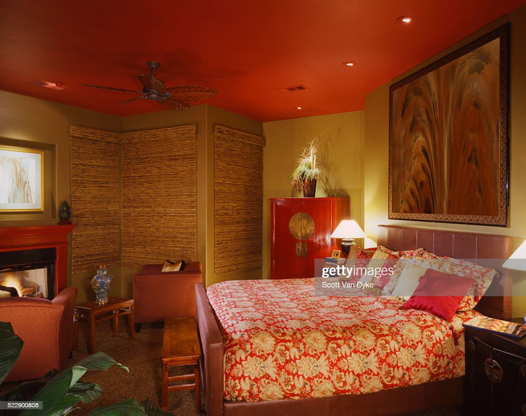 Gold Asianthemed Bedroom With Red Ceiling And Fireplace : Stock Photo