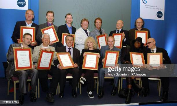 Gold Badge of Merit winners Back row Richard Digance Ben and Jonathan Finn Chairman of Songwriters Executive Guy Fletcher Sir Cliff Richard Larry...