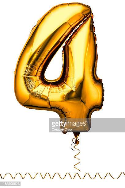 Gold balloon in the shape of a number four