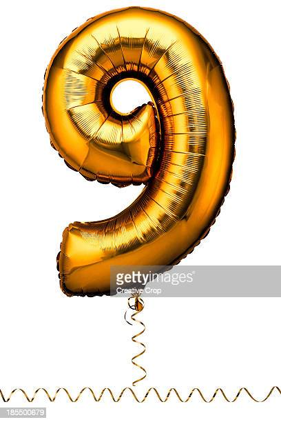 Gold balloon in the shape of a number nine