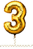 Gold balloon in the shape of a number three