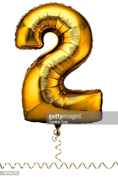 Gold balloon in the shape of a number two