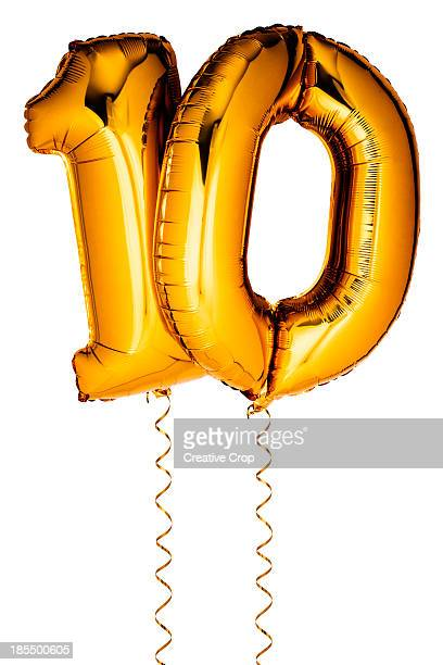 Gold balloons in the shape of a number 10