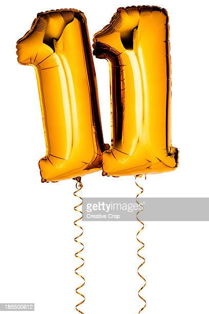 Gold balloons in the shape of a number 11