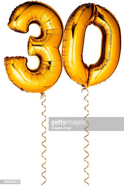 Gold balloons in the shape of a number 30