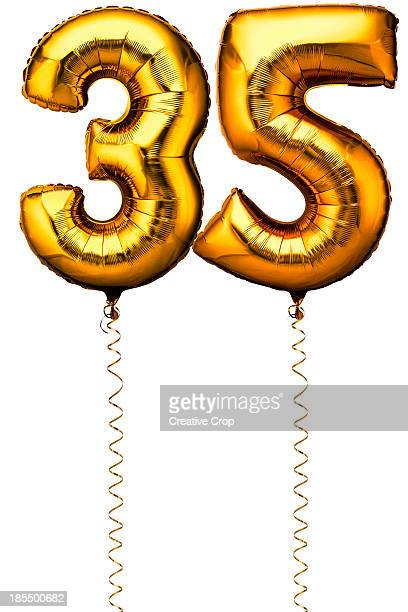 Gold balloons in the shape of a number 35