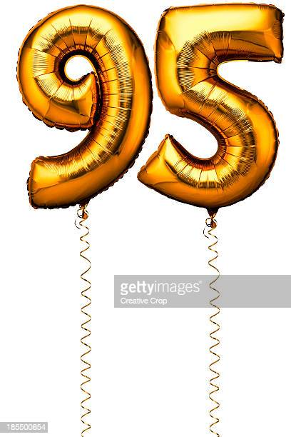 Gold balloons in the shape of a number 95