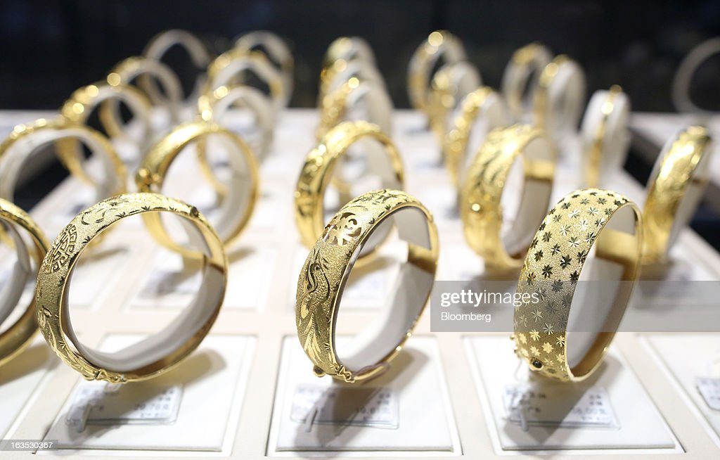 Gold bangles are displayed at the Chow Sang Sang Holdings International Ltd. jewelry store in the Sanlitun district of Beijing, China, on Monday, March 11, 2013. China's consumer prices climbed 3.2 percent from a year earlier, according to figures released March 9, exceeding January's 2 percent gain and the median estimate for a 3 percent increase in a Bloomberg survey of analysts. Photographer: Tomohiro Ohsumi/Bloomberg via Getty Images