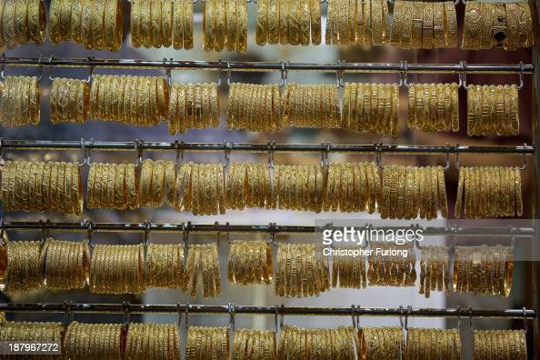 Gold bangles are seen on display in a window of a shop in the Gold Souk on November 13 2013 in Dubai United Arab Emirates Dubai is recovering from...