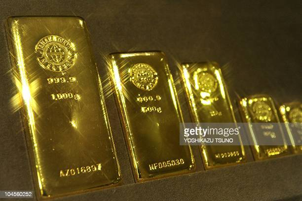Gold bars are displayed at Tanaka Kikinzoku Jewelry's Ginza shop in Tokyo on September 27 2010 Gold prices shot above 1300 USD for the first time and...