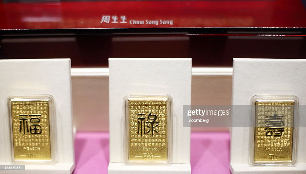 Gold bars are displayed at the Chow Sang Sang Holdings International Ltd. jewelry store in the Sanlitun district of Beijing, China, on Monday, March 11, 2013. China's consumer prices climbed 3.2 percent from a year earlier, according to figures released March 9, exceeding January's 2 percent gain and the median estimate for a 3 percent increase in a Bloomberg survey of analysts. Photographer: Tomohiro Ohsumi/Bloomberg via Getty Images