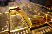 Gold bars are stacked on April 6 2009 at a plant of gold refiner and producer ArgorHeraeus in Mendrisio in the southern Swiss canton of Ticino While...