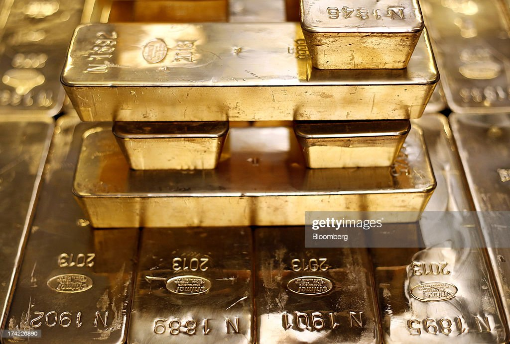 Gold bars bearing the hallmark of Chimet SpA, the Italian goldsmith company are seen at the precious metals refinery plant of Italpreziosi SpA in Arezzo, Italy, on Friday, July 19, 2013. Hedge funds raised bets on a gold rally before prices capped the biggest two-week gain in 20 months as Federal Reserve Chairman Ben S. Bernanke damped speculation that a cut in stimulus is imminent. Photographer: Alessia Pierdomenico/Bloomberg via Getty Images