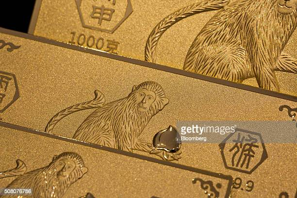 Gold bars featuring illustrations of monkeys sit on display at a Chow Tai Fook Jewellery Group Ltd jewelry store in Hong Kong China on Tuesday Feb 2...