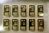 Gold bars of 100g ordered by Swiss bank UBS are displayed on April 6 2009 at a plant of gold refiner and producer ArgorHeraeus in Mendrisio in the...