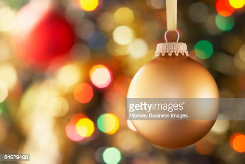 Gold Bauble Hanging On Decorated Tree : Foto de stock