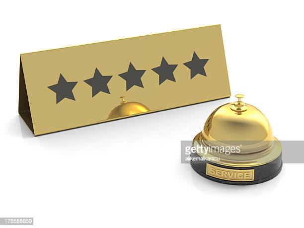 gold bell for five stars service on white