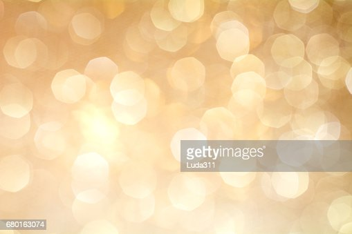 Gold Bokeh Background. The background with boke. : Foto stock